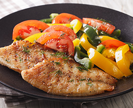 Taliapia fish fillets with sweet peppers and tomatoes