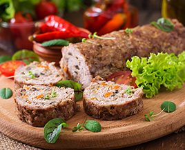 ground pork meatloaf on wood platter
