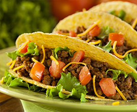 lean ground beef in tacos on green plate